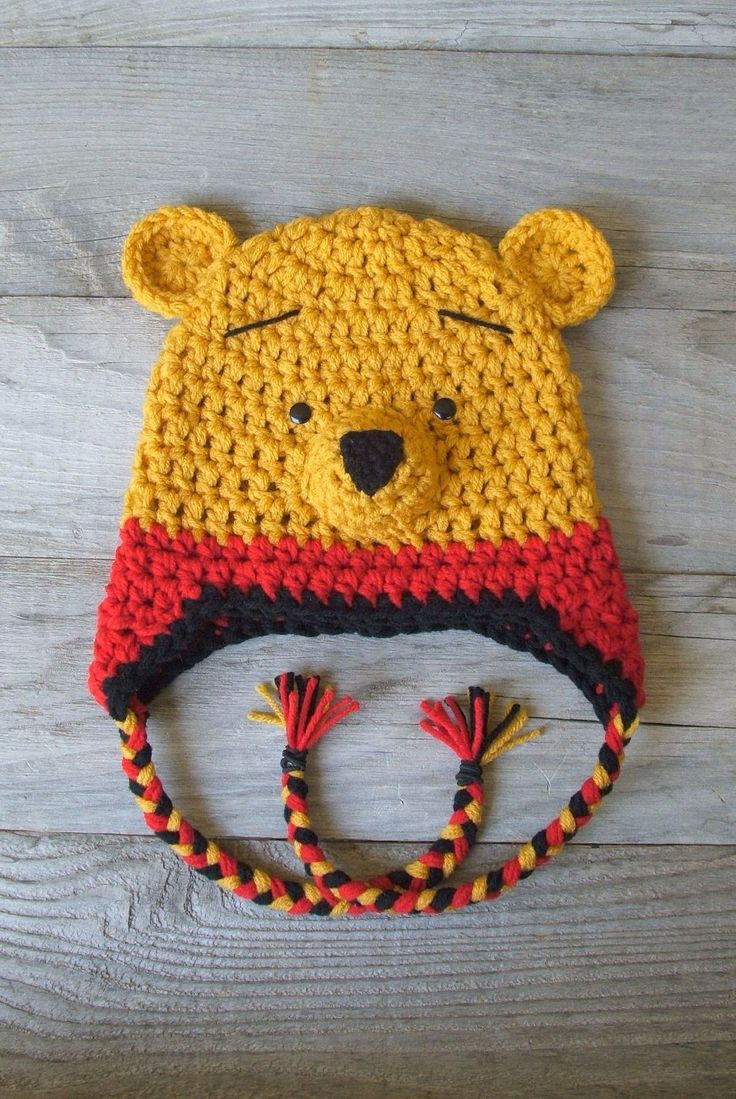 """Winnie the Pooh """"inspired"""" Hat w/Earflaps and Braids  (Newborn-3 month / 3-6 month / 6-12 month sizes). $35.00, via Etsy."""