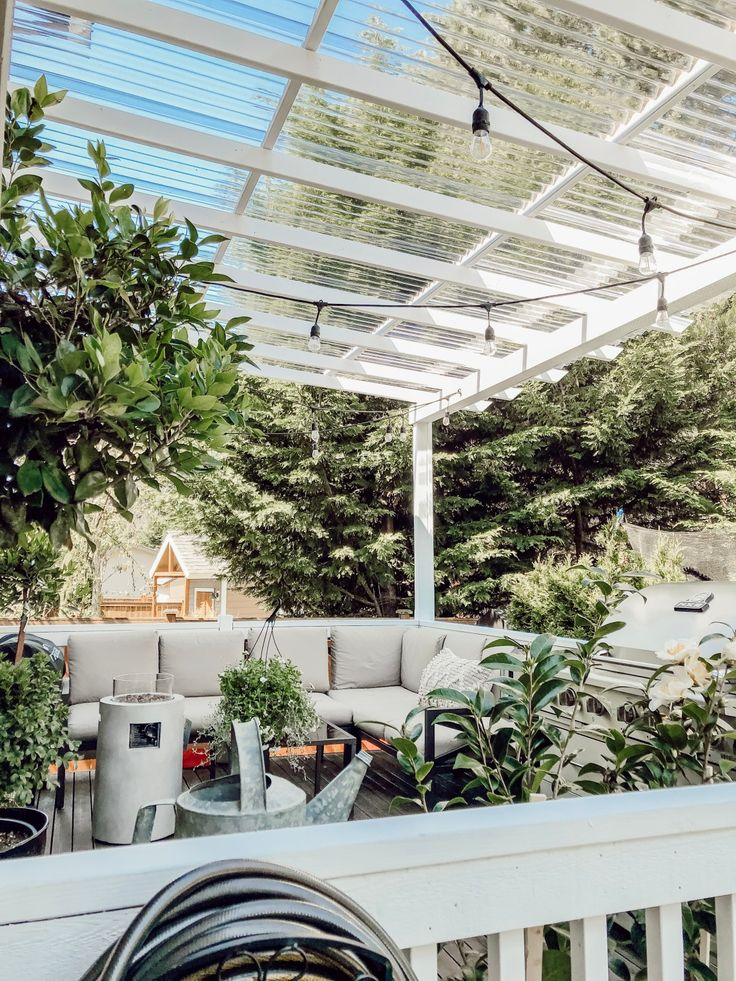 Diy clear corrugated covered pergola attached to the house