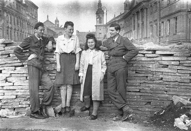 Warsaw Uprising 1944 Polish partisans relaxing behind a barricade....