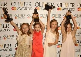 The four young actresses who play Matilda, Cleo Demetriou, Kerry Ingram, Eleanor Worthington Cox, Sophia Kiely, in Matilda The Musical celebrate their Oliviers. The musical, which won a record-breaking 7 Oliviers, was chosen as Best Musical. It's based on the popular children's book by Roald Dahl. Read about the show at http://allticketsinc.me/2012/06/15/