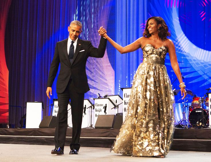 SEPTEMBER 17, 2016 U.S. President Barack Obama and First Lady Michelle Obama arrive on stage during the Congressional Black Caucus Foundation's Phoenix Awards Dinner in Washington, DC.