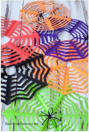 Kirigami Spider Webs For Halloween #halloween #homedecor #diy http://livedan330.com/2014/10/22/kirigami-spider-webs-halloween/