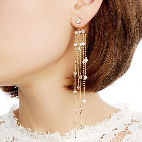 Золотистые серьги с кристаллами на длинных цепочках