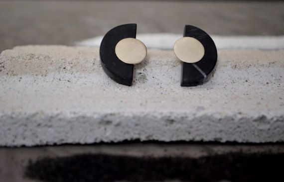 SALES ITEM FROM 90€ NOW 49€!  Semicircle shape earrings made of Greek marble and sterling silver metal details! They are light and very elegant! You can wear them all day and match them with every style. The black marble is from Vitina. MARBLE OF VITINA:  Vytina is a mountain village and a former municipality in Arcadia, Peloponnese, Greece. The village is located at the foot of the mountain range Mainalo. The area produces marble, a variation called the Black of Vytina.Its dark black color…