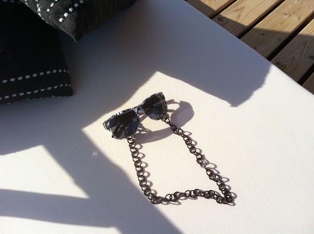 Black metallic sunglasses chain. Summer accessories.