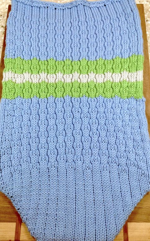 This is another of the baby cocoons I knitted this weekend.  This one is done in mock rib and tuck stitch. My niece picked baby blue, lime green and gray for her colors for her son who is due in Ap…