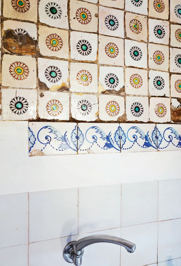 From a restored home in Barcelona where the architect left these worn tiles as is.