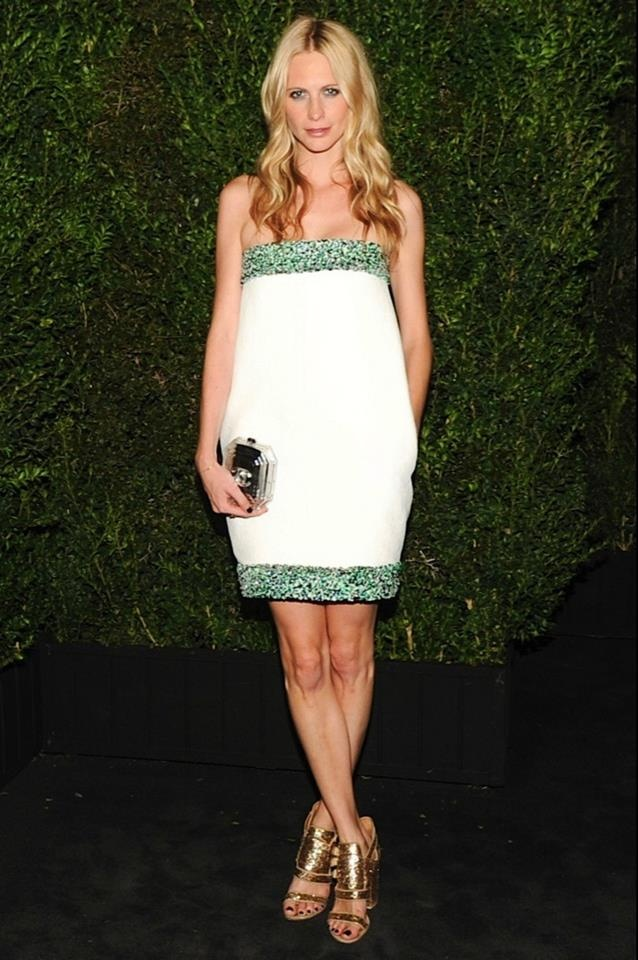 Poppy Delevingne wore a short strapless white dress with green and navy sequin trim from the Spring/Summer Ready to Wear 2013 Collection #Stunning #fashion #Oscar #chanel