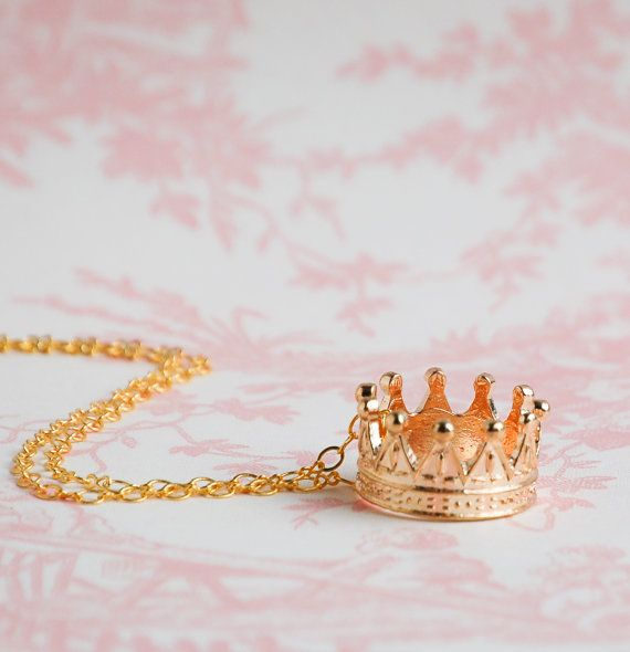 This is such a fun golden crown pendant. This royal looking charm hangs from a gold tone chain or you may choose an antique style chain. Perfect