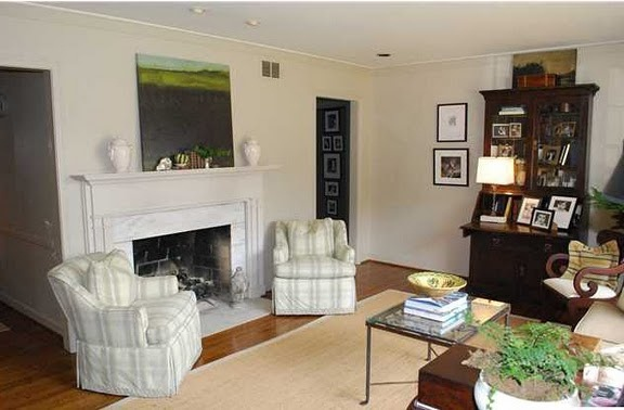 I like how the two chairs are configured around the fireplace.