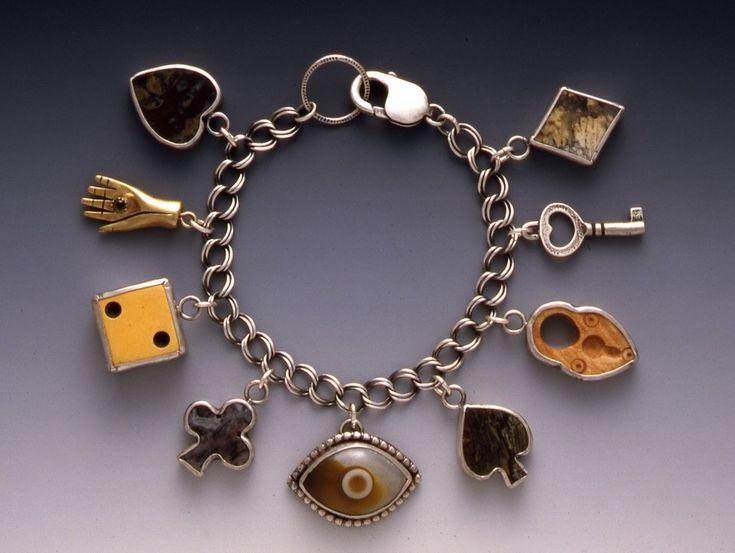 https://i.pinimg.com/736x/69/8d/49/698d49eab55c265d40b13afd1a63497f--charm-necklaces-charm-bracelets.jpg