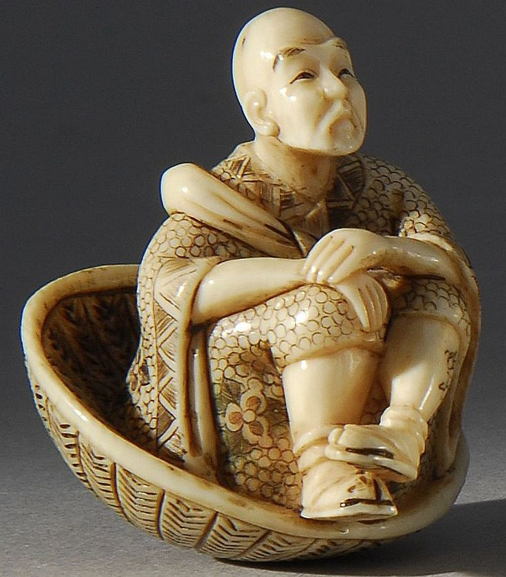 Lot 215: IVORY NETSUKE Depicting a man seated in a large straw hat. - Eldred's | Invaluable