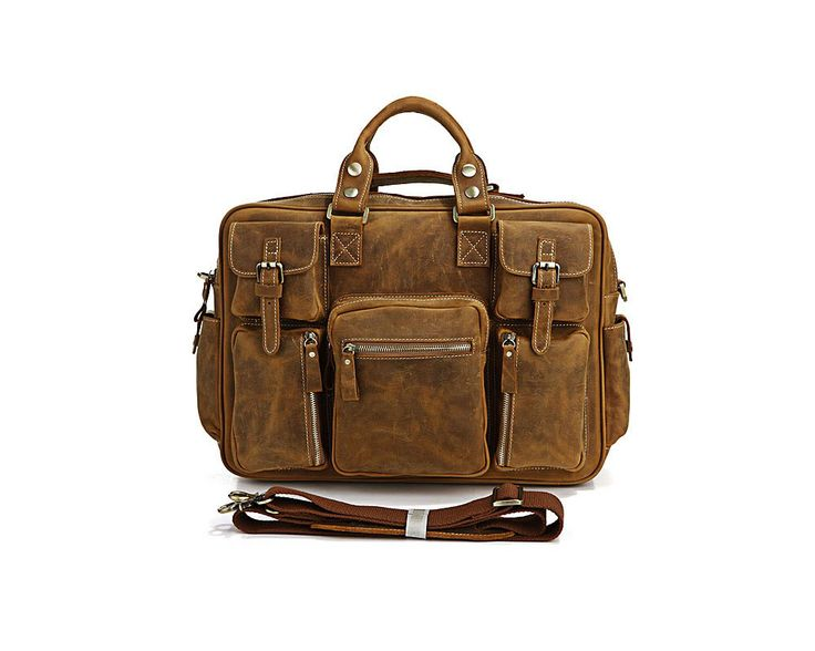 A large and interesting leather bag featuring multiple external pockets. The leather is a wax coated genuine leather.