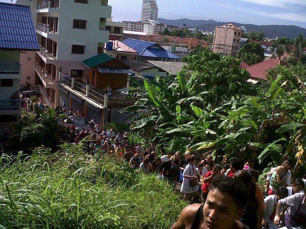 People is walking to safe zone.   Credit to Tong Wattana Chonsongkram.