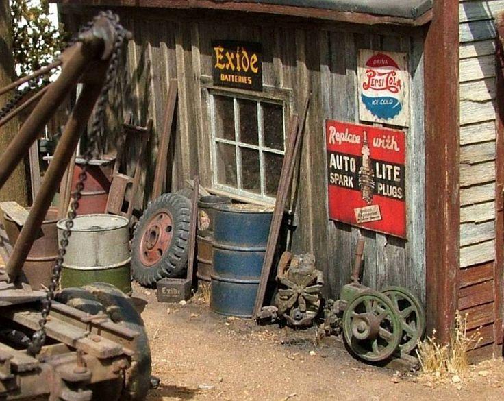 Add model scenery like gravel, talus, dead grass to set a realistic scene - Red Oak Services Station 1/48 Scale Model Diorama
