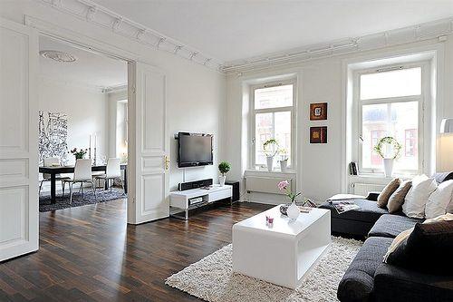 dark floors, white room: even the tv works, here. styling by alvhem