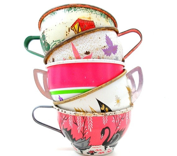 reminds me of Camille Rose Garcia  50s Tin Toy Tea cups, Swans & leaves in pink green white on 5 metal.