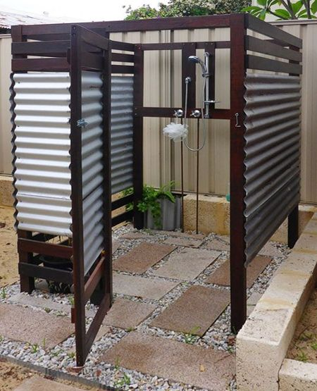 Build an outdoor shower with timber and corrugated sheeting.