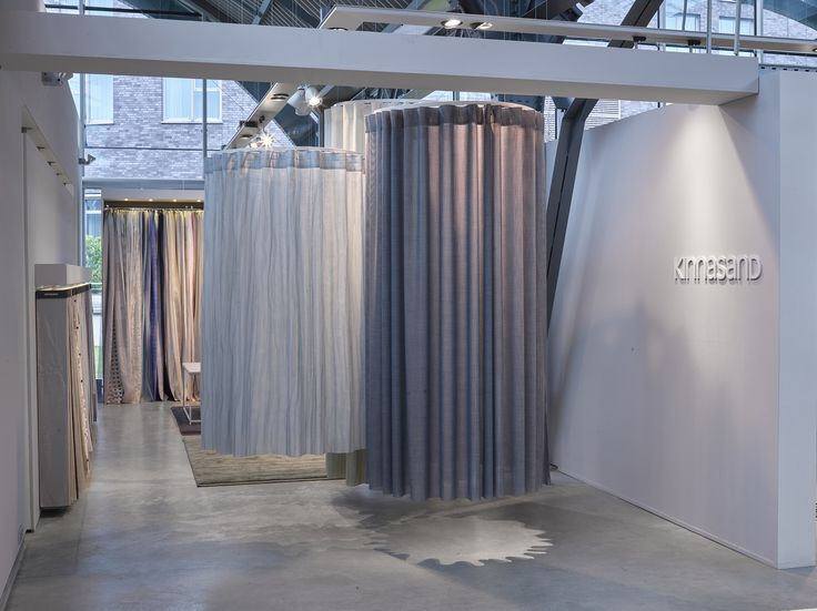 Draped curtains at the Kinnasand stand at Design Post, Cologne