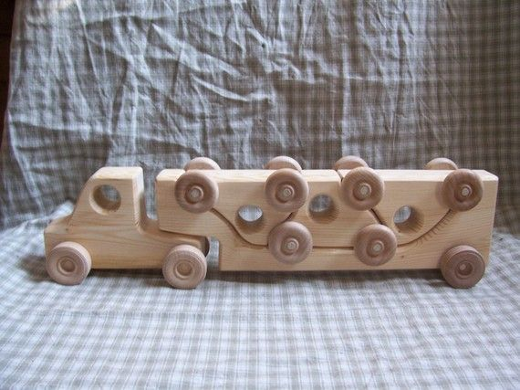 This is a perfect toy for children. Its a toy truck with three cars that fit on the trailer like a puzzle. It is safe and has no sharp edges. No chemicals are used (no varnishes or stains). Four toy cars in one.