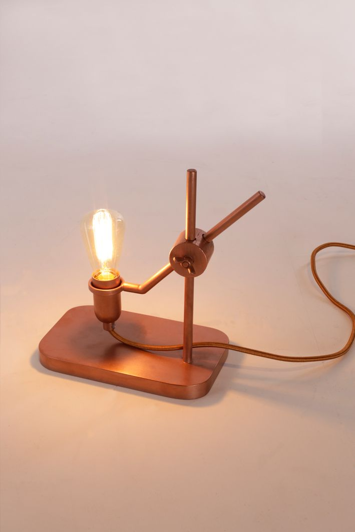 MATERIAL Copper  DIMENSIONS (WxHxD) Lighten Up: 200x240x120 mm  CONCEPT A lamp loved by a wide audience, with an open and honest design, that lasts a lifetime. That's what Jolanda van Goor had in mind when she designed this hand-made and adjustable table lamp, made of metal and wood. They are available in copper and bronze, and in combinations of pink with copper, black with bronze, and white with bronze.  PHOTOGRAPHY Studio Jolanda van Goor  YEAR 2015