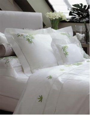 linens by Yves Delorme (another name synonymous with luxury linens) skillfully marries the clean lines of modern design with the traditional art of embroidery, creating a unique and artful modern rendering of romantic style.