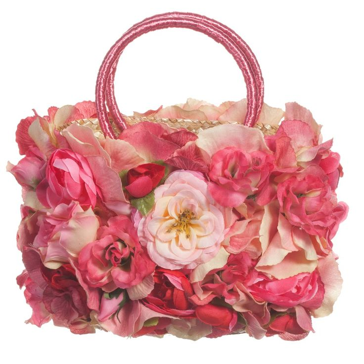 I Pinco Pallino very pretty girls little straw basket covered in pretty polyester silk flowers in different shades of pink. With a main compartment big enough <span>to keep all these girly necessities at hand and has two hooped handles perfectly sized for little hands.<br /> <br /> Big Size:<br /> 16cm x 14cm x 6cm<br /></span> <ul> <li>100% straw</li> <li>Polyester silk flowers</li> <li>Spot clean</li> <li>Suitable for ages 3-16 years</li> <li>Made in Italy</li> </ul>