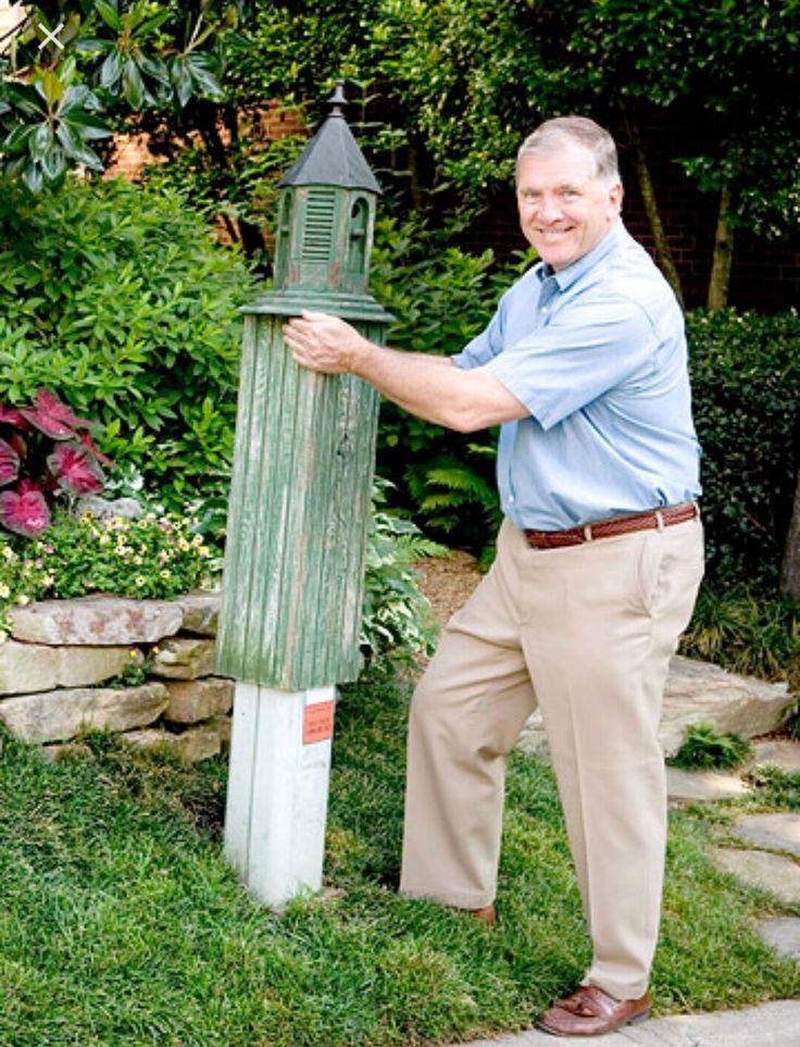 Hiding the outdoor electric box with a bird feeder.