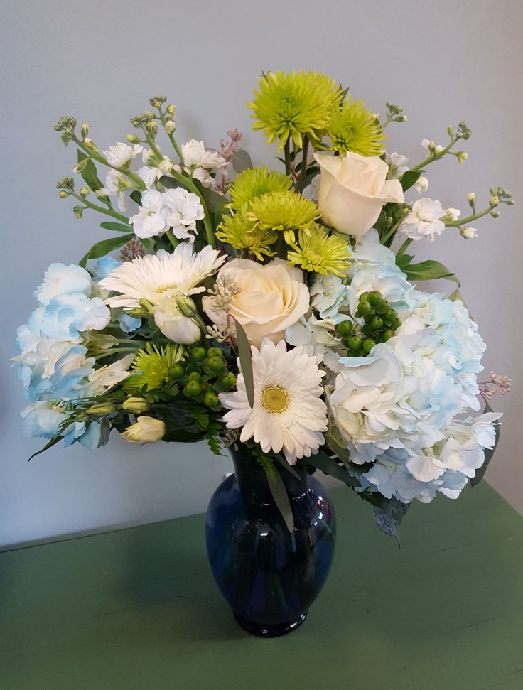 Congratulate the new Mom with this beautiful bouquet of hydrangea, roses, mums, stock, daisies, and hypericum berries.