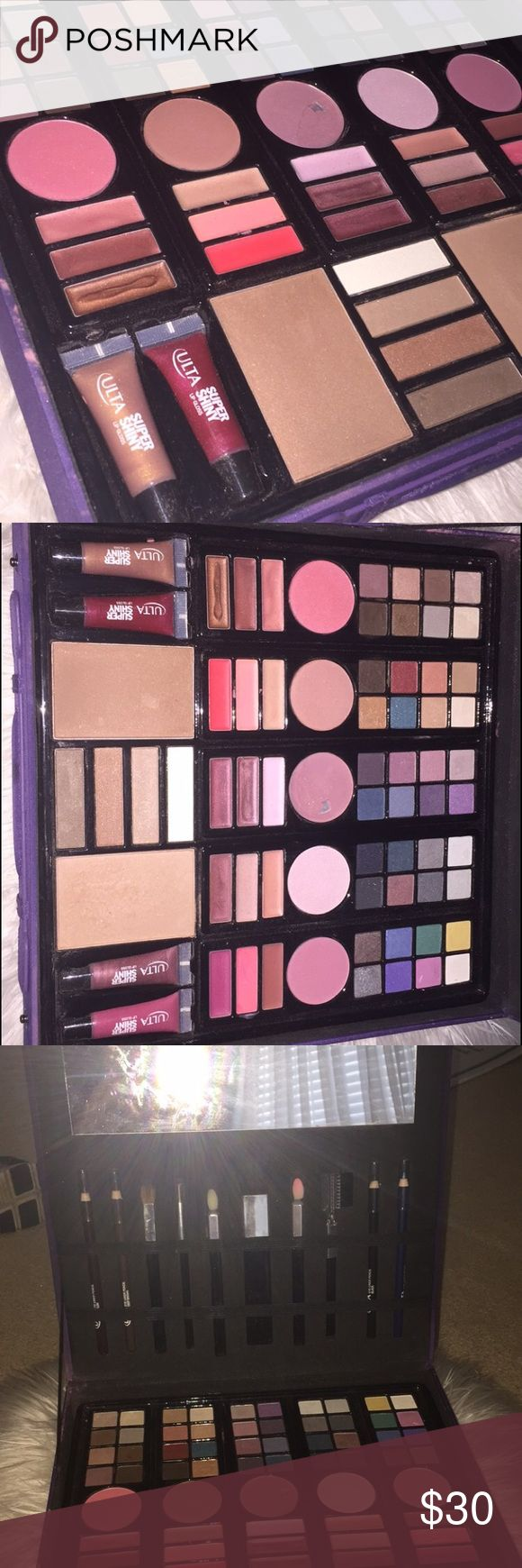 Ulta purple make up kit Make up slightly used includes eyeshadows, blushes, bronzers, lip glosses, eye liner pencils, brushes and highlighter. Brushes and some eye pencils have been used makeup that has been used Is visible in photos ULTA Makeup