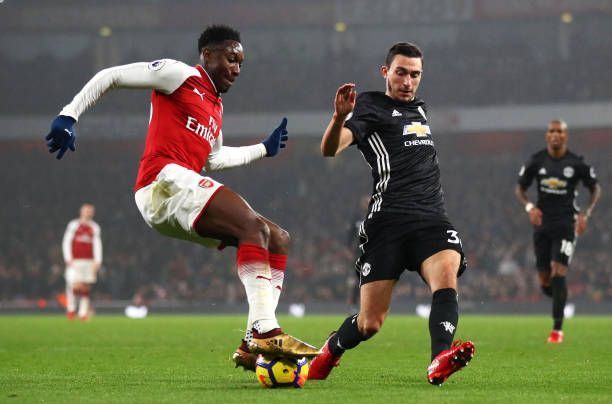 Danny Welbeck of Arsenal is challenged by Matteo Darmian of Manchester United during the Premier League match between Arsenal and Manchester United...