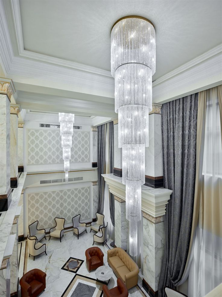 The grand lobby of the Biltmore Hotel in Tbilisi, Georgia, echoes the nostalgia of a bygone era. Immaculately restored, it resonates the glamour and prestige of the social elite. Two 4.5 meter long chandeliers, each composed of 23,000 crystal octagons, match the atmosphere of the lobby. #light #lighting #design #designlighting #interior #chandelier #hospitality #hotel #lobby #hotellobby