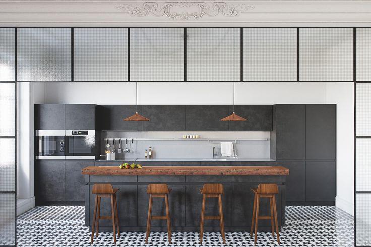 Vista de la cocina, delimitada por una estructura de hierro y vidrio y un suelo de mosaico de baldosas.