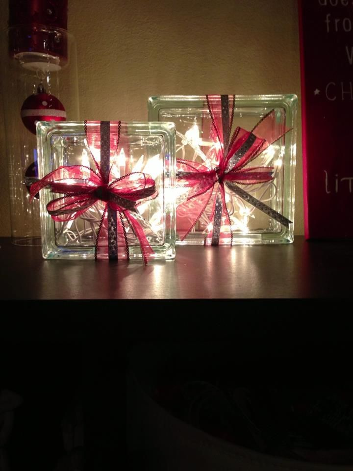 glass blocks filled with Christmas lights and wrapped with ribbon- I bought my mother-in-law one of these a few years back. I'm going to make me one!