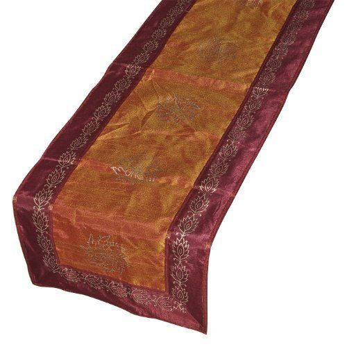 Dining Accessory Table Runner Rectanuglar Dupioni Silk, Orange by DakshCraft. $30.80. Dupioni silk table runners gives an authentic look to your dining table or kitchen table. An advantage to creating a table runner by hand is the vast choice of fabrics, patterns, and designs available. People who want to make luxurious runners can even choose fabric from design. It gives a traditional look to your kitchen room or dining room. Buy it for yourself and present it to your near...