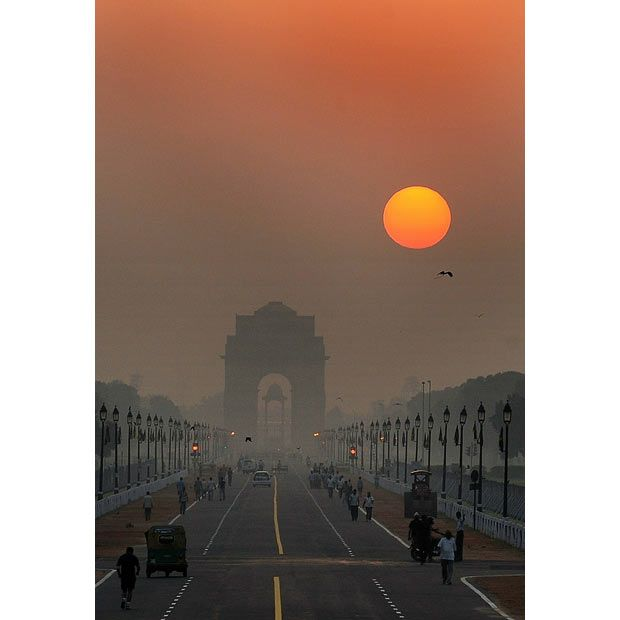 Sunrise over the historic India Gate in New Delhi, India