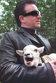 Irish rock band U2's lead singer Bono and guitarist Edge hold sheep after receiving the Freedom of the City at Dublin's St.Stephen's Green on March 1, 2000. Following an old Irish tradition, those who are given Dublin's freedom of the city, have the right to pasture their sheep at the central Dublin St.Stephen's Green.
