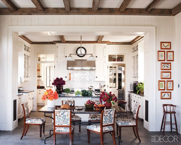 Rustic wood beams and slate-gray tiles unite the kitchen and informal dining