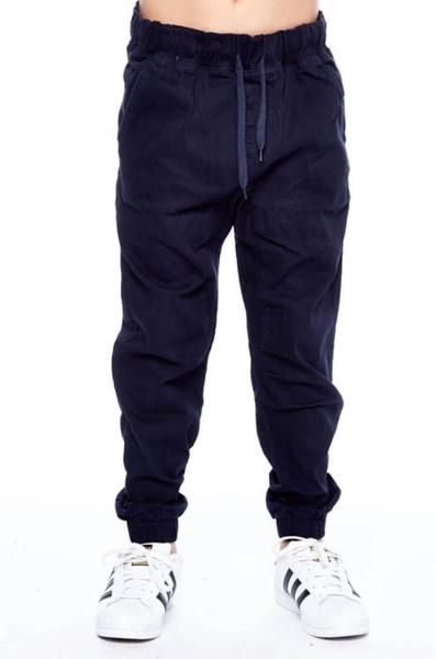 The perfect basic Twill Joggers in navy blue! Draw string waist, Pockets and elastic around the ankles. Fits baggy.  98% Cotton, 2% Spandex
