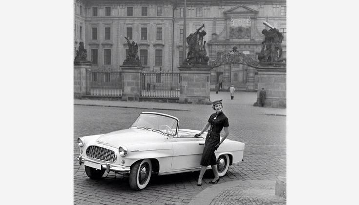 The Miss America 1957 poses with a Skoda car.