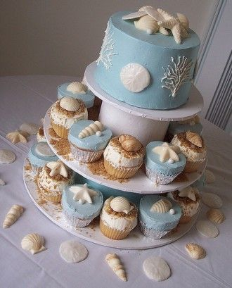 Beach theme wedding cakes but they look more lie Rococo fancies to me ...