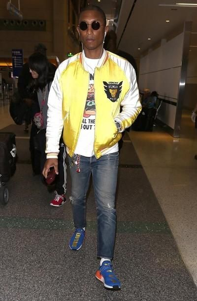cheap for discount 57213 40e91 Pharrell Williams pairs a burger tee with a yellow bomber jacket by Human  Made.