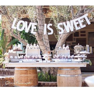"""Loving this """"sweets"""" set up for Gloria and Artie's engagement celebration! Congrats!! Thank you @glowconceptsfinelinens for the photo!! #winebarreltable #winebarrel #engagementparty #rusticwedding #rusticdecor #rusticcake #caketable #loveissweet #rusticurbanevents #rusticevents #rusticchic #rusticbride #theknotbestofweddings #scbmember #socalbrideblog #socalwedding #socalbride #desserttable"""