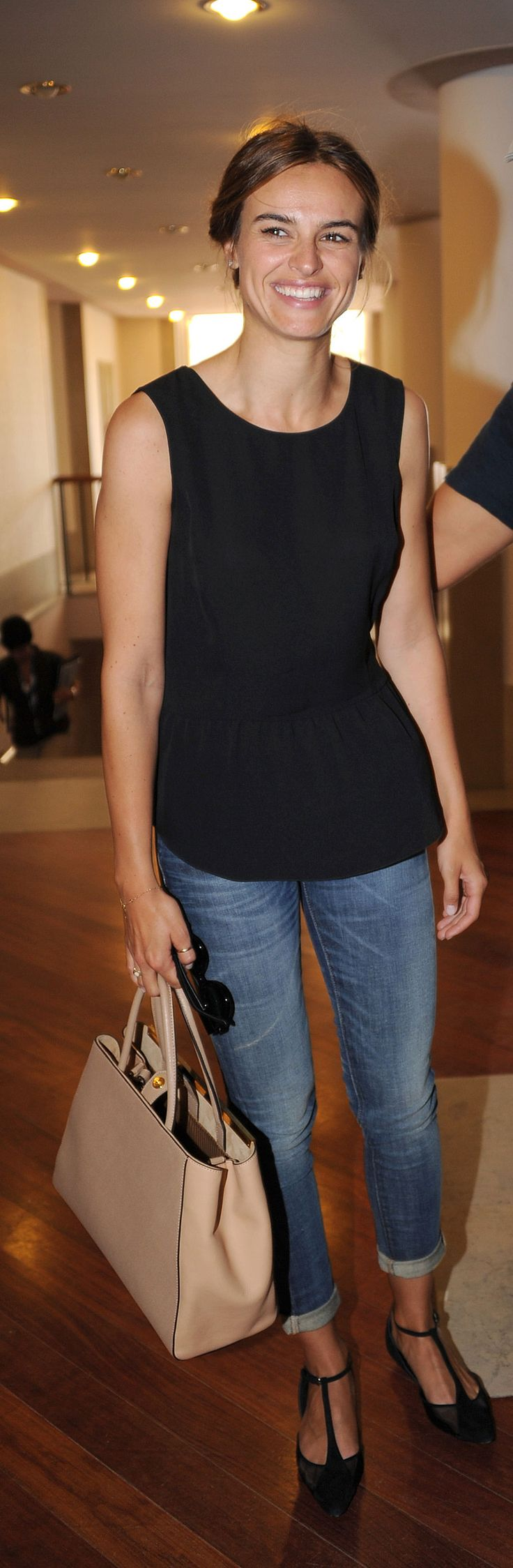Kasia Smutniak donned a peplum top with cuffed jeans and T-strap flats for a sweet daytime look.