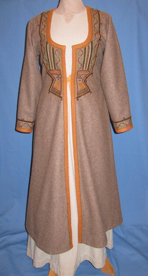 Embroidered Viking caftan full view. See also the close up of the embroidery and a very similar (the same?) caftan worn in the snow.