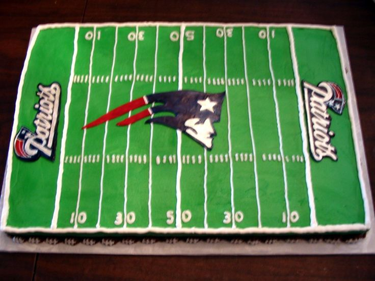 New England Patriots football field - My niece is a die hard Patriots fan (or Tom Brady fan...) and wanted this for her birthday.  The end zone and center field decorations are painted candy clay.  The rest is buttercream.  Bordered with a brown puff border decorated with white laces to resemble little footballs.  Hope she likes it.