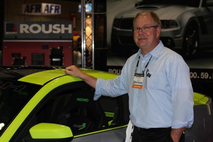 Get Green Racing's Mark Daniel stands beside one of the 2012 PRI's many racing cars.