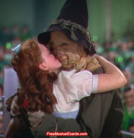 Judy Garland as Dorothy with Scarecrow played by Ray Bolger.