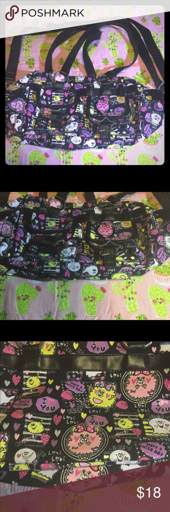 Kawaii Sanrio San-X Ghost Purse Bag Decora Colorful and cute Japanese bag purchased from a stationary store in Houston, TX! Black background with a print of colorful fluff ball creatures and ghosts, with 4 outer snap pockets (the 2 in front are accented with star-shaped buckles) and 2 interior pockets. Perfect for the Japanese street fashion lover; definitely looks like something from an old issue of Fruits magazine, and would compliment Your Harajuku-inspired look! ⚡️Bundle or make me an…