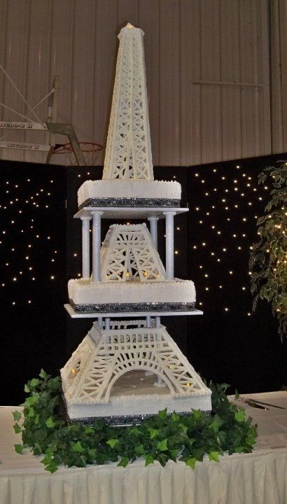 Eiffel Tower ~ All buttercream finished. The tower ifself was made of royal icing. This cake served 550 guests and was 6 feet tall